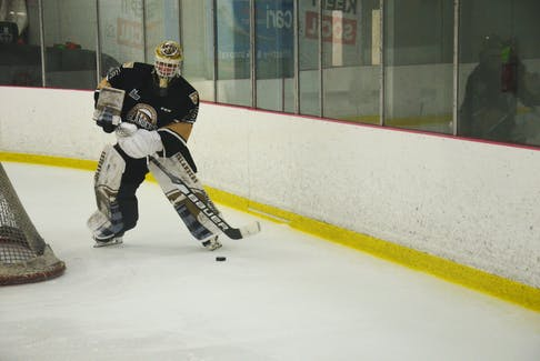 Charlottetown Islanders goaltender Jacob Goobie plays the puck during a pre-season game in the Quebec Major Junior Hockey League at MacLauchlan Arena recently. Goobie is entering his third season with the Islanders.