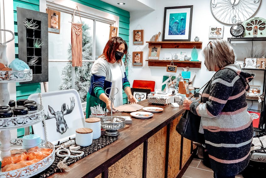 Joanne Dooley-Butler, who co-owns Funky Junk with daughter Emma Dooley, says it's taken creativity and local support for their small business to survive. - Photo Contributed.