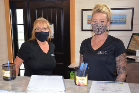 Charlene Gill, left, co-owner of Family & Friends Restaurant in Kensington, stands behind the restaurant's counter with server Courtney Crosby. Both women are concerned over the upcoming P.E.I. Vax Pass policy, particularly how the business will manage enforcement with so many part-time staff in school and an ongoing labour shortage.