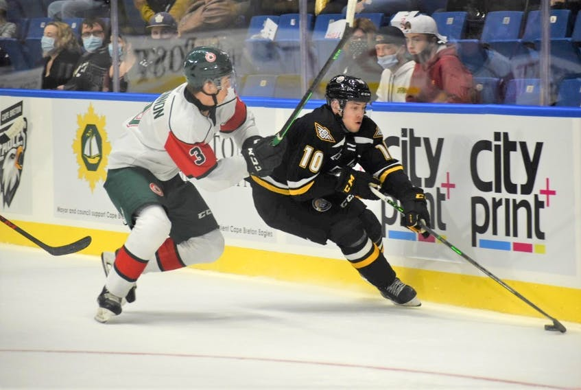 Halifax Mooseheads defenceman Dylan MacKinnon, left, tries to contain Cape Breton Eagles forward Connor Trenholm during Friday's QMJHL game in Sydney.