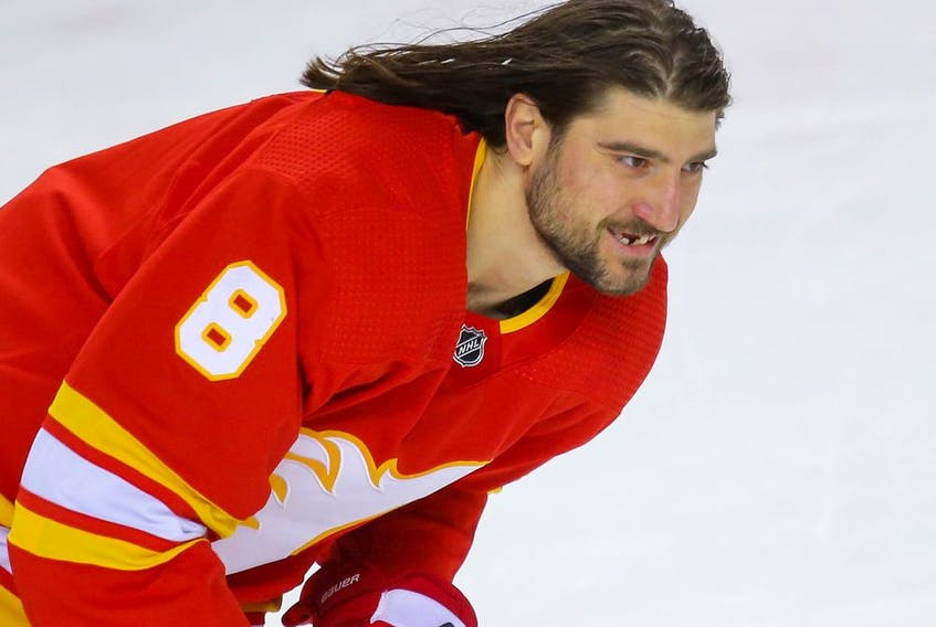 Flames blueliner Chris Tanev takes warmup before a game against the Edmonton Oilers in this photo from Feb. 19.