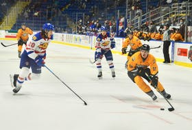 Cape Breton Eagles forward Connor Trenholm, right, has his eyes on the net after a solo rush down the left flank during second period action of Sunday afternoon's game against the Moncton Wildcats at Centre 200 in Sydney. Trenholm scored on the play after speeding past Moncton defenceman Charles-Antoine Pilote, left. DAVID JALA/CAPE BRETON POST