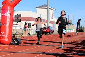Holly Harris and Brett Doggett, both of Halifax, complete the Valley Harvest Marathon's half marathon Oct. 10 in Wolfville.