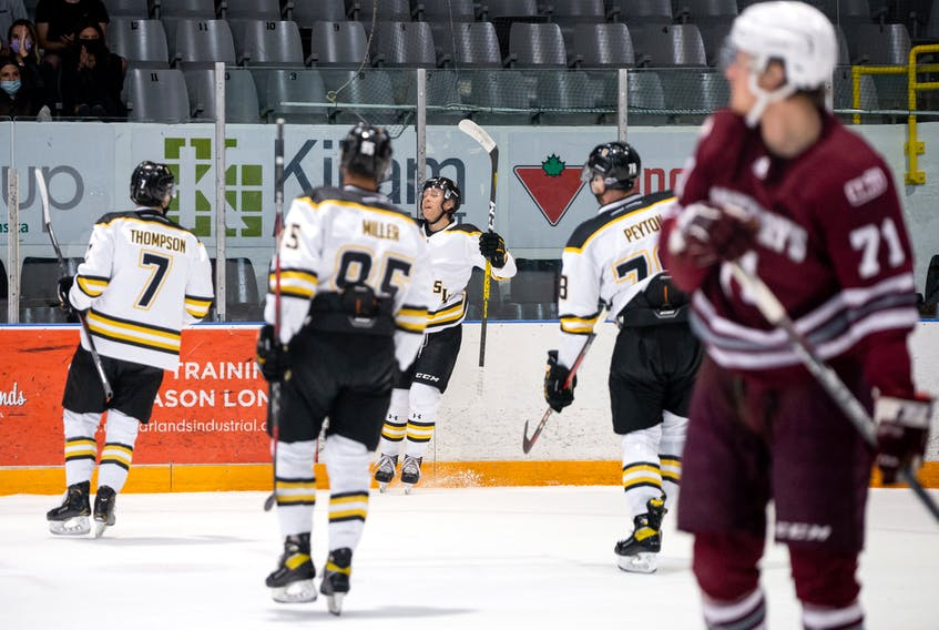 Dalhousie Tigers players celebrate a goal against the Saint Mary's Huskies in AUS men's hockey action on Saturday.  The Tigers won 4-3. – Trevor MacMillan