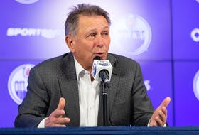 Edmonton Oilers general manager and president of hockey operations Ken Holland speaks on the opening day of 2021-22 training camp at Rogers Place in Edmonton on Sept. 22, 2021.