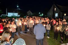 A candlelight vigil was held Sunday evening in memory of the two teenage girls who were killed in a Glace Bay house fire early Friday morning. Above, Undercurrent Youth Centre director Dave Sawler encouraged those in attendance to take care of each other and to be there when needed.