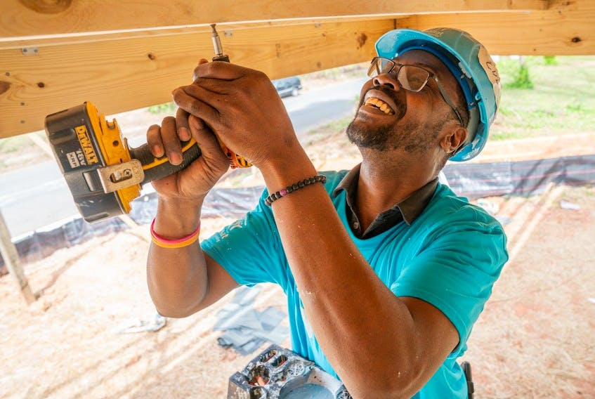 Oct. 11, 2021 - A volunteer with Habitat for Humanity works on a recent build project.