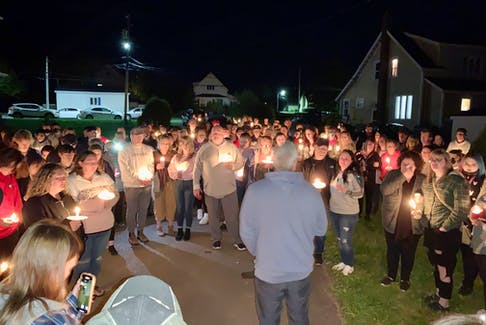 A candlelight vigil was held Sunday evening in memory of the two teenage girls who were killed in a Glace Bay house fire early Friday morning. Above, Undercurrent Youth Centre director Dave Sawler encouraged those in attendance to take care of each other and to be there when needed. David Jala/Cape Breton Post