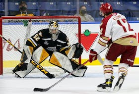 Cape Breton Eagles goalie Nicolas Ruccia was in the zone on Monday aagainst the high-flying Acadie-Bathurst Titan. Above, Ruccia concentrates on the puck as Titan star forward Riley Kidney bears down on goal. Kidney was denied on the play but would come back to score the game-winning goal on the powerplay with just 22 remaining in overtime to give the visitors a 2-1 win at Centre 200 in Sydney. MIKE SULLIVAN PHOTO