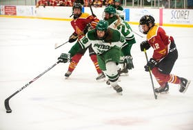 Jolena Gillard of the UPEI Panthers reaches the puck during an Atlantic University Sport women's hockey game against the Mount Allison Mounties at MacLauchlan Arena on Oct. 9. Chelsea Krahenbil, right, pressures Gillard while UPEI's Mireille Martin and unidentified Mount Allison player follow the play. Gillard had two goals and two assists to lead the Panthers to a 4-1 victory. UPEI Athletics Photo