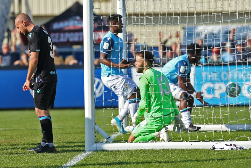 Halifax Wanderers Akeem Garcia, fishes the ball out of the net in front of Pacific FC keeper, Callum Irving, following teammate Samuel Salter's game-winning goal, during 2nd half CPL action at the Wanderers Grounds Monday October 11, 2021. The Wanderers defeated the CPL's top club, 1-0.  TIM KROCHAK PHOTO