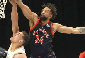 Raptors centre Khem Birch says he and his family were battling COVID-19.