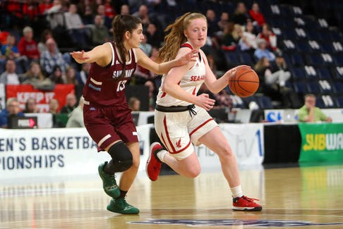 Memorial Sea-Hawks guard Alana Short (right), shown playing against the Saint Mary's Huskies during the 2020 AUS women's basketball playoffs, had the top single-game scoring performance in the Sea-Hawks' pre-season road trip over the weekend, scoring 30 points against SMU. — File photo/AUS