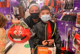 Charlie Quigley is a huge fan of the video game Fortnite. And while originally he wanted to dress up like the character Skull Trooper, he went with Tomatohead instead. Pictured with him is his mother, Jodi.
