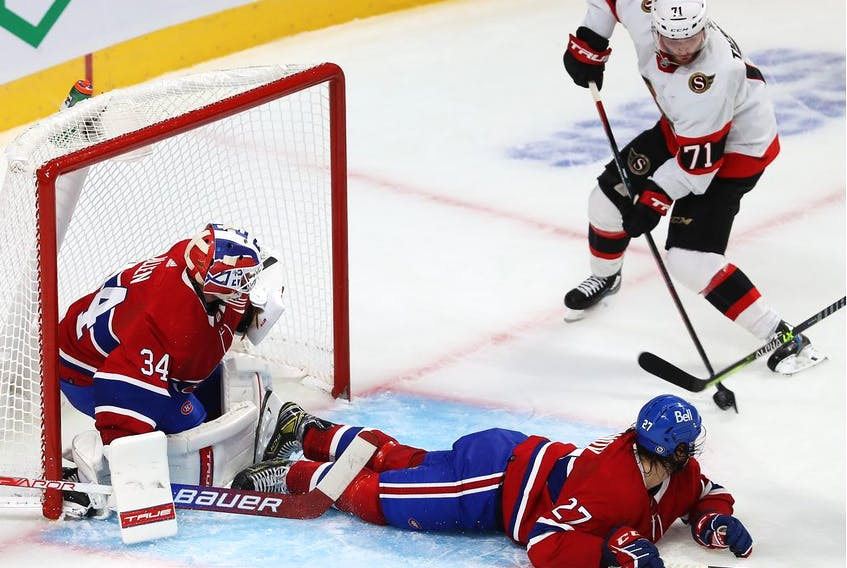 Ottawa Senators' Chris Tierney shoots on Montreal Canadiens goaltender Jake Allen as Alexander Romanov defends during second period in Montreal on Oct. 7, 2021.