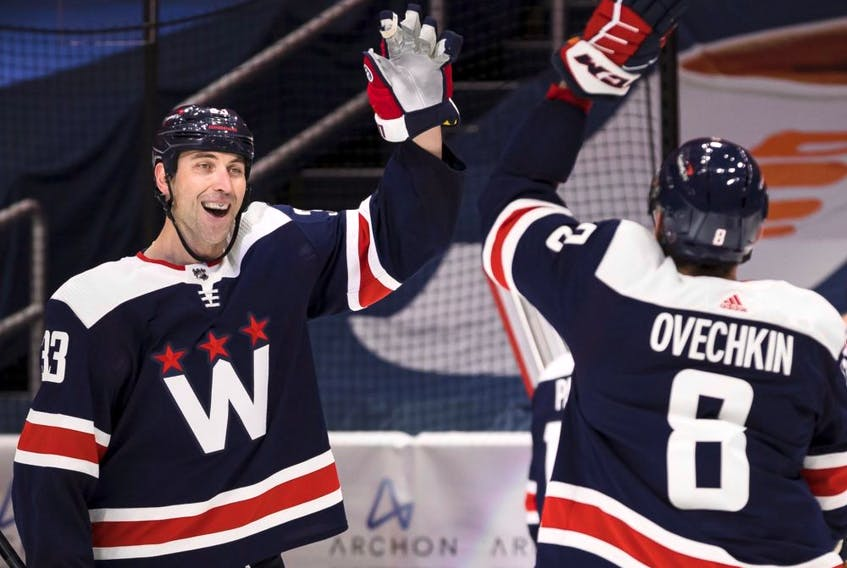 Defenceman Zdeno Chara (left) has returned to the Islanders, while Alex Ovechkin continues to chase the NHL's career goals record.
