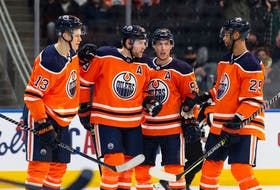 Edmonton Oilers' Leon Draisaitl (29) celebrates a goal with teammates on Vancouver Canucks' Jaroslav Halak (41) during the first period of preseason NHL action at Rogers Place in Edmonton, on Thursday, Oct. 7, 2021.