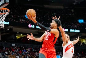Houston Rockets' Christian Wood drives to the basket against Raptors' Scottie Barnes during the first half at Scotiabank Arena on Monday, Oct. 11, 2021.