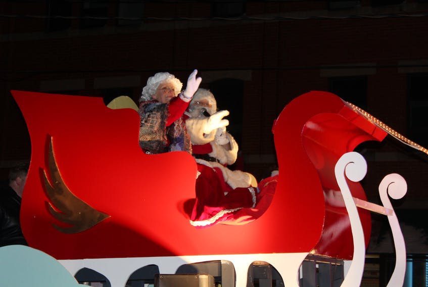 Mrs. Claus, left, and Santa Claus greet Charlottetown children at the 21st annual Christmas Parade in thi file photo.
