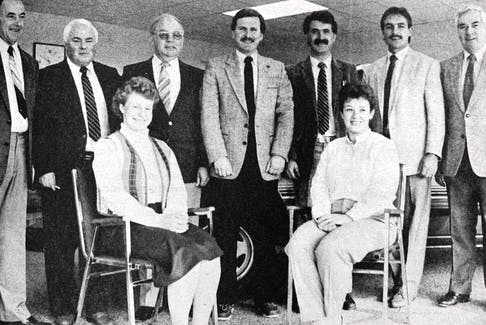 Pothier Motors celebrated its 25th anniversary in 1986 by opening a new showroom in Falmouth. Gathered for a sales and office staff shot were, from left, standing: Tom Pothier, Ernie Spencer, Bernie Grant, Brian Redden, Randy Shield, John Pothier, and Carl (Chook) Smith; seated: Lynn Porter and Pat Skelhorn.
