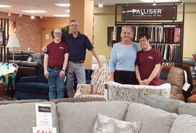 Bruce Shea (left) and David Horne (right) are employed by Island Furniture through its Supported Employment program, which provides meaningful employment with appropriate and ongoing support.