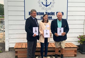 Sandy MacMillan, left, and Andreas Josenhans, two thirds of Nova Scotia's legendary soling crew were inducted into the Sail Canada Hall of Fame on Oct. 3. Dr. Dana Archibald, middle, represented skipper Glen Dexter, who was unable to attend the event in Kingston, Ont. - Contributed