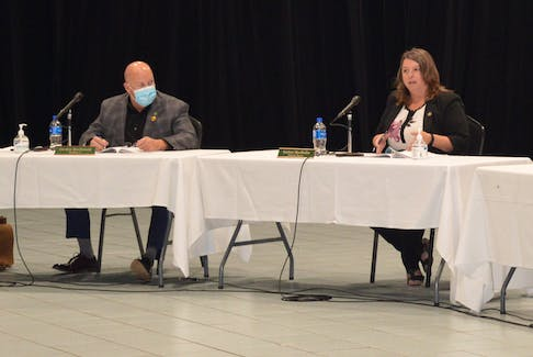 CBRM councillor Gordon MacDonald listens as Deputy Mayor Earlene MacMullin voices her views on a potential vaccination policy for the municipality during Tuesday night's council meeting at Centre 200. — IAN NATHANSON/CAPE BRETON POST