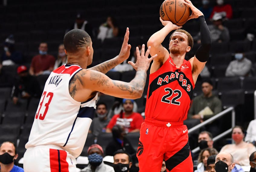 Raptors' Malachi Flynn (right) shoots the ball against Washington Wizards forward Kyle Kuzma during the first half at Capital One Arena on Tuesday, Oct. 12, 2021.