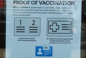 A restaurant in Charlottetown displays a sign telling patrons they need to show proof of vaccination.