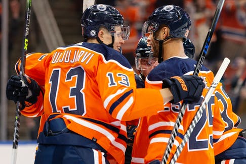 Edmonton Oilers forward Jesse Puljujarvi (13) celebrates a goal with teammates against Vancouver Canucks goaltender Thatcher Demko (35) at Rogers Place in Edmonton on Wednesday, Oct. 13, 2021.