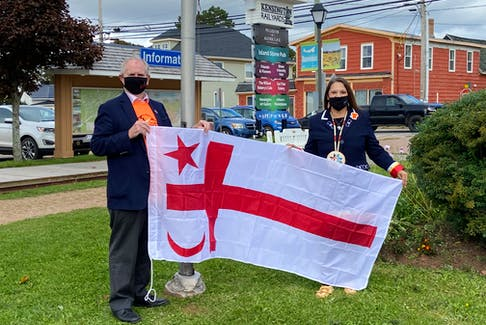 Kensington Mayor Rowan Caseley and Lennox Island First Nation Chief Darlene Bernard display the Mi'kmaq Grand Council Flag that was raised outside of Kensington Town Hall on Oct. 1.
