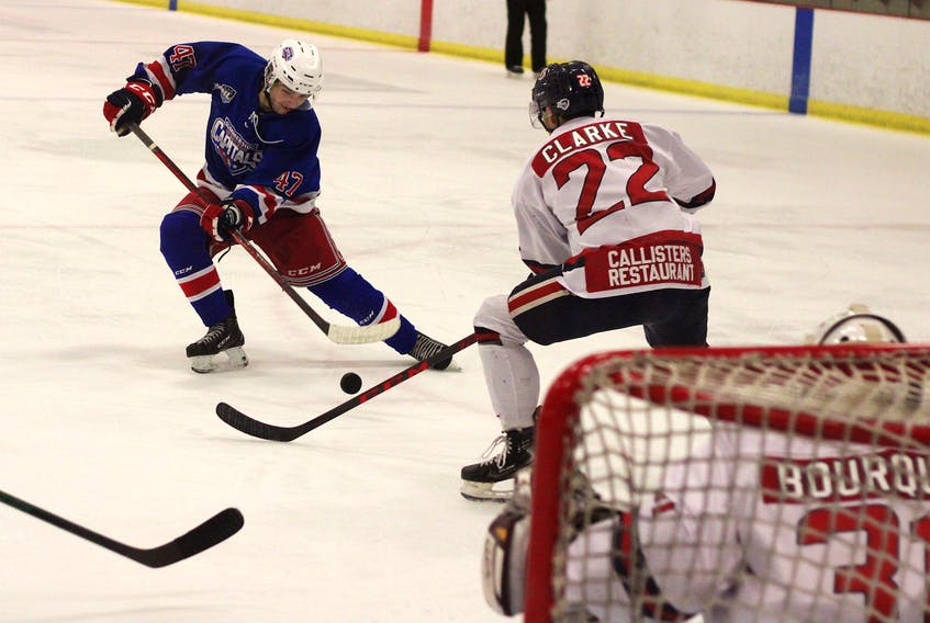 Summerside D. Alex MacDonald Ford Western Capitals defenceman Ed McNeill, left, tries to get a shot off while being defended by Valley Wildcats blue-liner Aiden Clarke during Maritime Junior Hockey League action Oct. 13 in Berwick.