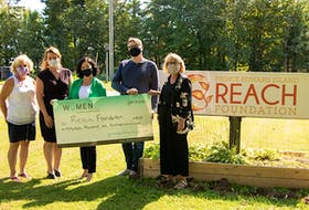 Members of 100 Women Who Care P.E.I. have donated $19,100 to the Reach Foundation. Pictured, from left, are Aileen Matters, Cheryl Paynter, Kathleen Casey, who are members of 100 Women Who Care P.E.I., Reach Foundation executive director Dean Constable and Reach Foundation president Cheryl Roche.