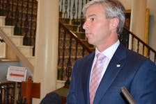 Premier Tim Houston speaks to reporters at Province House in Halifax on Thursday, Oct. 14, 2021.