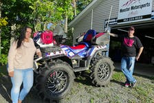 Jenn Cameron, an ATV safety instructor, and Ryan Sejberg, who has a life-long passion for motorsports pose with their eye-catching machine they have dubbed Air Force One.