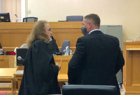 George Pottle (right) speaks with defence lawyer Bob Buckingham after Pottle's assault trial finished in Newfoundland and Labrador Supreme Court in St. John's Thursday, Oct. 14. Justice Donald Burrage will return early next month with his decision.