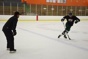 UPEI Panthers associate coach Darryl Boyce watches defenceman Conor MacEachern go through a skating drill at a recent practice. The Panthers return to action at MacLauchlan Arena in the Atlantic University Sport Men's Hockey Conference against the St. Francis Xavier X-Men on Oct. 15 at 7 p.m.