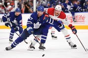 Maple Leafs' Pierre Engvall (left) pursues the puck ahead of Montreal Canadiens' Jeff Petry during the second period at Scotiabank Arena on Wednesday, Oct. 13, 2021.