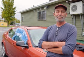 John Patrick, 57, stands outside his car he has been living in behind a store in Sydney since the first of summer. Patrick credits kindness of the store owner and neighbours for making his homeless situation more bearable. Sharon Montgomery-Dupe/Cape Breton Post