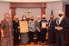 100 Women Who Care - Prince County were awarded the Mayor's Medal of Honour on Tuesday, Oct. 12. Shown, from left: Deputy Mayor Norma McColeman, Elizabeth Noonan, Krista MacDougall, Nicole Morrison, Marie Salamoun-Dunne, Katherine Kelly, nominating committee chair Hazel Hilchey and Mayor Basil Stewart.