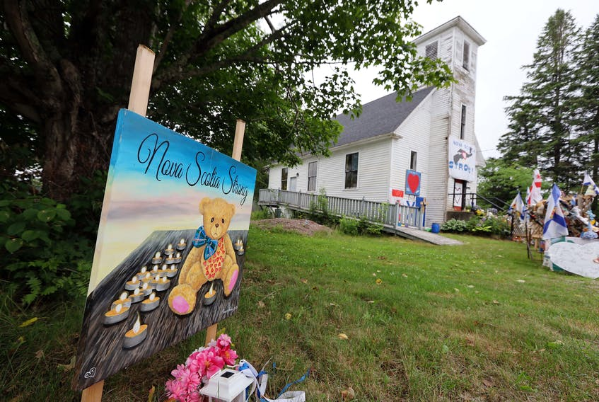 July 23, 2020—Items of condolence overflow on the steps and yard in front of the old Portapique Church. The commission of inquiry investigating the mass killing is delaying hearings scheduled for October until late January.  ERIC WYNNE/Chronicle Herald