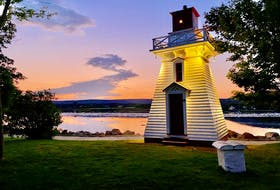The historic lighthouse in Annapolis Royal is lit up as dusk falls with a sunset backdrop to add to its beauty. TINA COMEAU