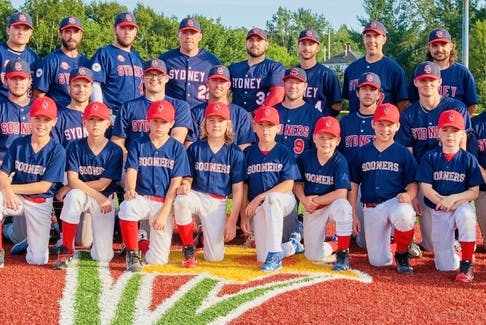Members of the Sydney Sooners under-11 'AA' team were invited to attend one of the Sydney Sooners Nova Scotia Senior Baseball League games during the season. After the game, the senior team took time to get a picture with the juniors. The junior Sooners, pictured in the front row, from left, Jamie Morrison, Avery Johnston, Liam MacLeod, Ben Perry, Parker Spencer, Ben Gouthro, Breslin Marshall, Marty MacLeod, Ethan Shepard, Brendan Young, Cailex Tournidis and CJ Lanceleve. The senior Sooners, in no particular order, Mike Tobin, Chris Farrow, Andrew Brewer, Jordan Sheppard, Sean Ferguson, Justin Brewer, Jordon Shepherd, Reilly O'Rourke, Danny MacKillop, Corey Christie, Kenny Long, Rob Biron, Brayden Boutilier, Parker Hanrahan, Brett MacMullin, Darson Murphy, Keagan Murrin, Corson O'Rourke, Guy Pellerine, Brett Sibley, Sheldon MacDonald and manager Jim (Rico) McEachern. CONTRIBUTED • CHRIS TOURNIDIS