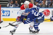 Jake Evans of the Montreal Canadiens battles against David Kampf of the Maple Leafs during Wednesday's game. CLAUS ANDERSEN/GETTY IMAGES