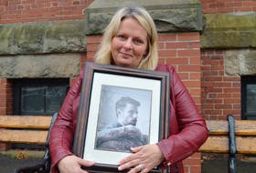 Shari Affleck holds a picture of her son, Luke Allen, who died last month following complications from a double lung transplant he had in 2019.