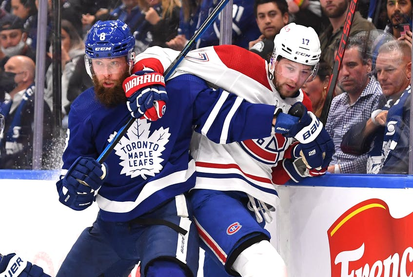 Maple Leafs' Jake Muzzin (left) battles on the boards with Montreal Canadiens' Josh Anderson during Wednesday's game in Toronto. DAN HAMILTON/USA TODAY SPORTS