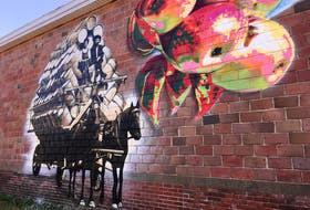The Berwick Mural Society's first project shows a team of horses hauling a wagon full of apple barrels.