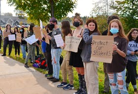 Students from Avon View High School in Windsor protested on the sidewalk on Wentworth Road on Oct. 12, calling on school administration to do more to address the problem of sexual assaults. KIRK STARRATT