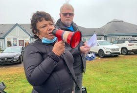 Retired nurse Bonnie McNeil speaks to a rally outside Springhill's All Saints Hospital protesting the reduction in hours of the hospital's emergency department to address a nursing shortage at the Cumberland Regional Health Care Centre near Amherst while rally organizing committee member Don Tabor looks on. Darrell Cole – SaltWire Network