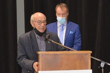 Martin Chernin, president of Harbour Royale Development Ltd., with his lawyer Dwight Rudderham, speaks to CBRM council Tuesday night on his new developmental request, minus the addition of a new library. IAN NATHANSON/CAPE BRETON POST